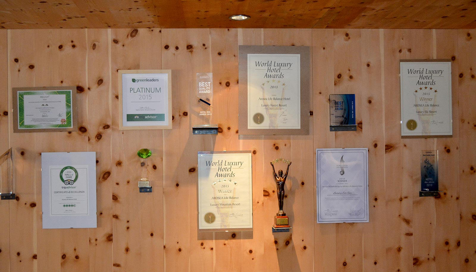 Awards of Arosea Hotel in Ultental-Val d'Ultimo on a wooden wall