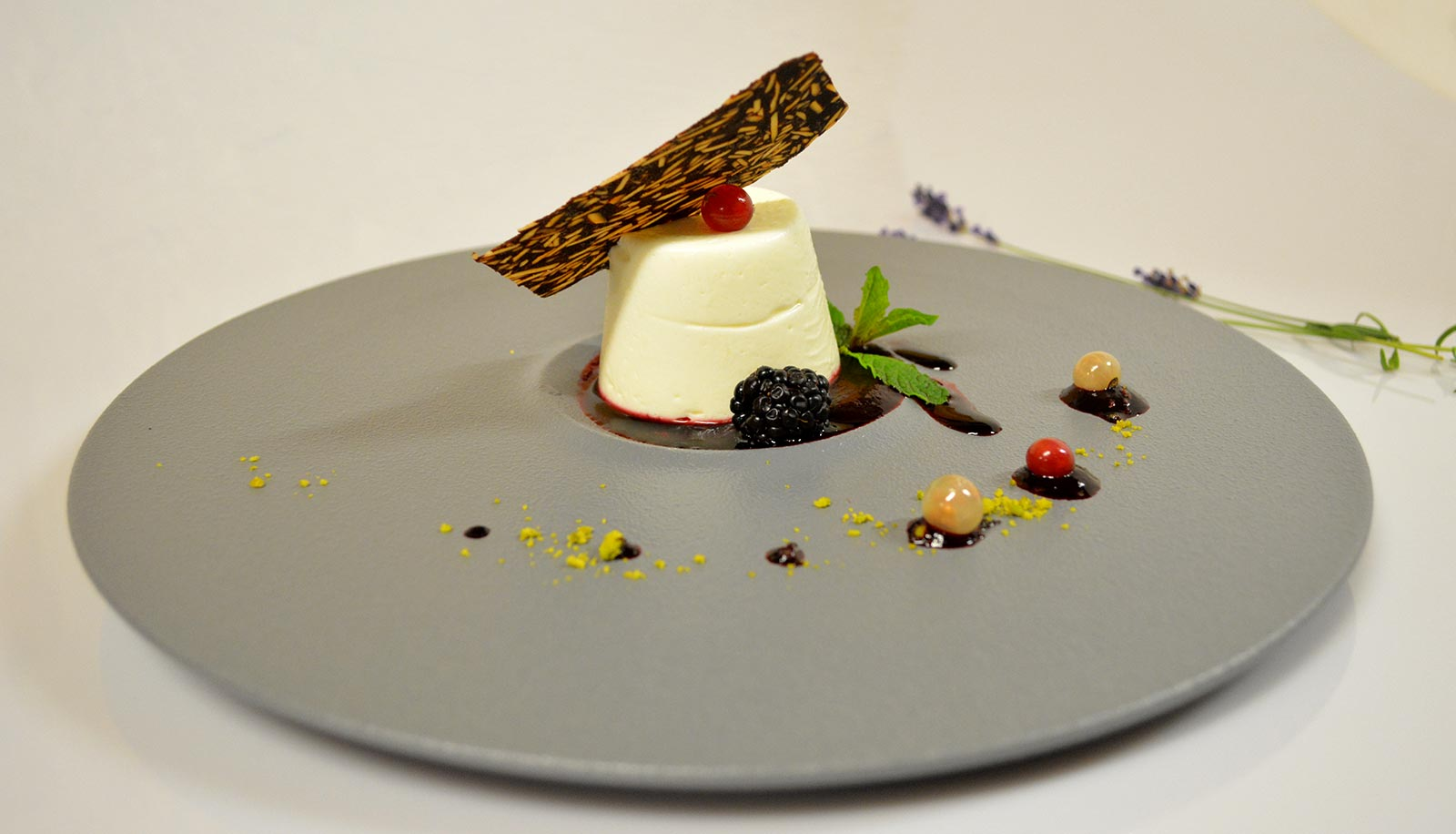 Panna cotta on a fruit sauce with decoration and small fruits