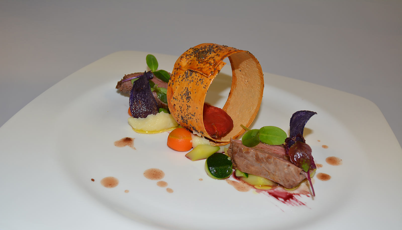 Gourmet dish with meat and vegetables