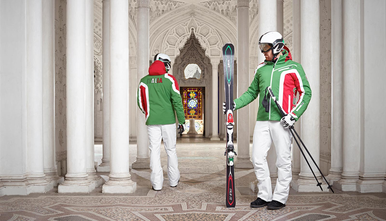 Two fully equipped skier in a Middle Eastern looking hall