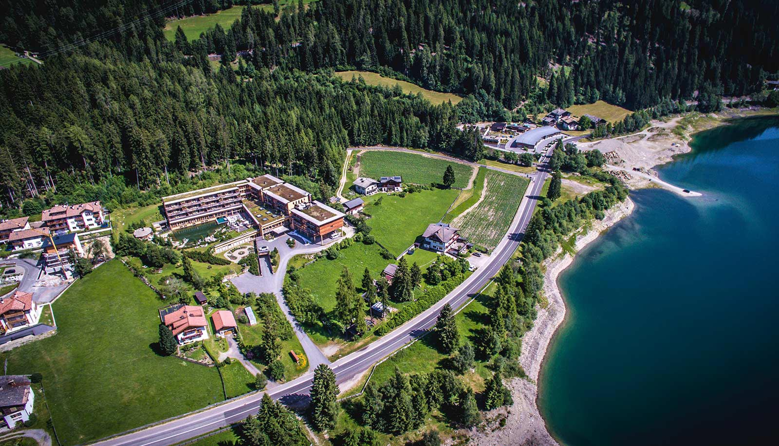 Arosea Hotel in Ultental-Val d'Ultimo on the shore of the lake seen from above